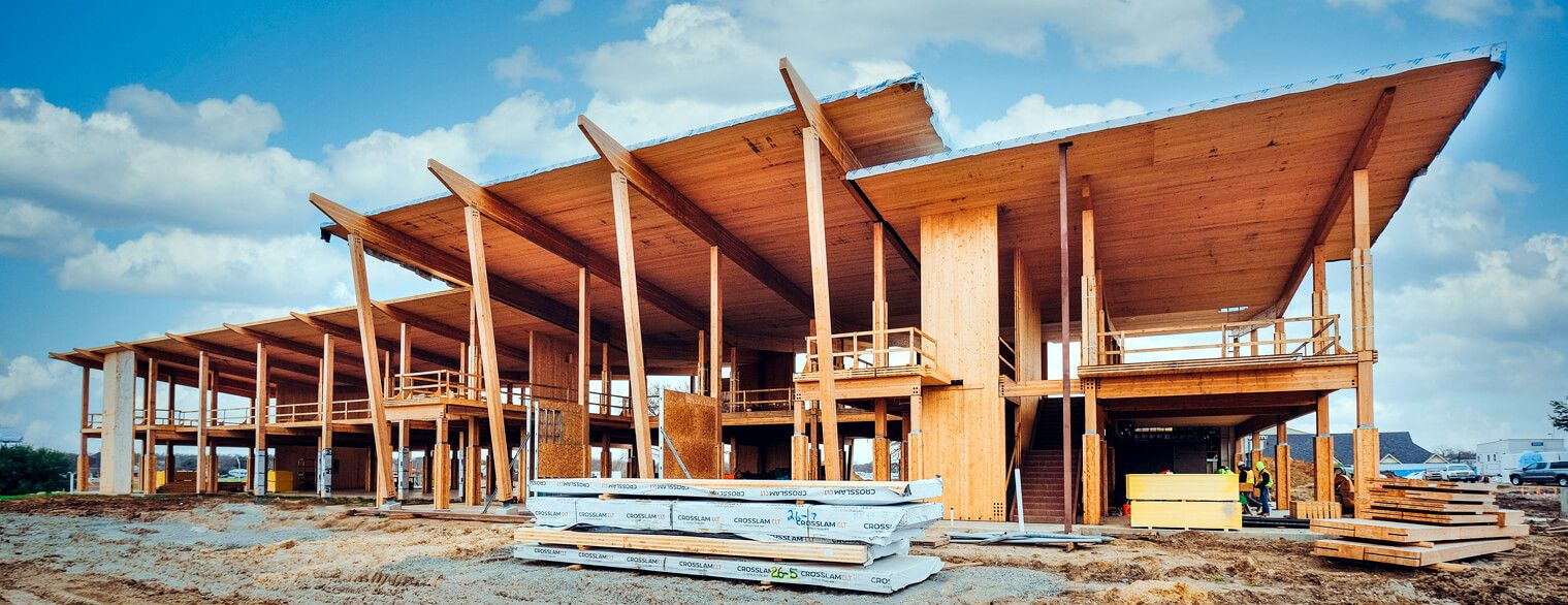 Mass timber commercial structure frame raising